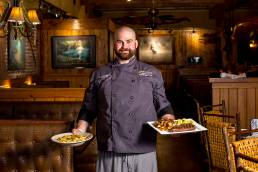 chef holding up two meals
